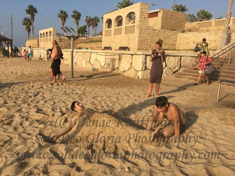 Arkan buried Mustafa in the sand.
