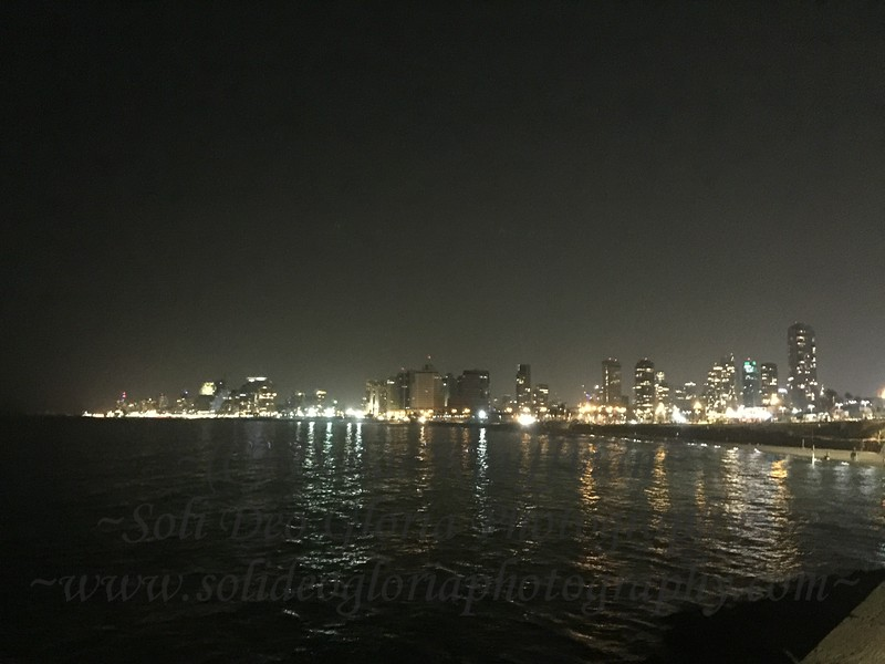 Part of the Tel Aviv waterfront skyline at night.