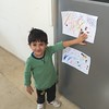 Samir proudly shows off his artwork that we made this morning!