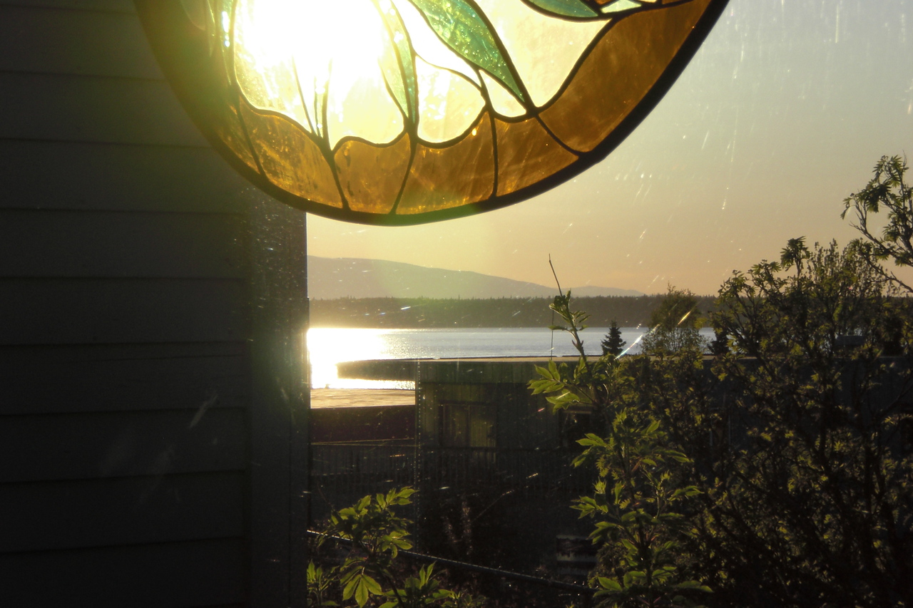 The summer sun in Alaska is never far from the horizon. In this photo at the Cafe,  it's 9:00PM and still more than an hour from setting.