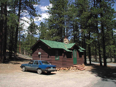 CABIN HS-5 This would be home sweet home for my stay here in Bryce Canyon, one of the historical structures (HS, get it?) in the park. Very cozy with a combination kitchen/dining room, a single bedroom -- which also served as my living room -- and a bathroom. You wouldn't think it, but everything I brought with me in Ol' Blue (including my Sony Home Theater System, but no TV) packed that little place to the gills. Can I pack or what?