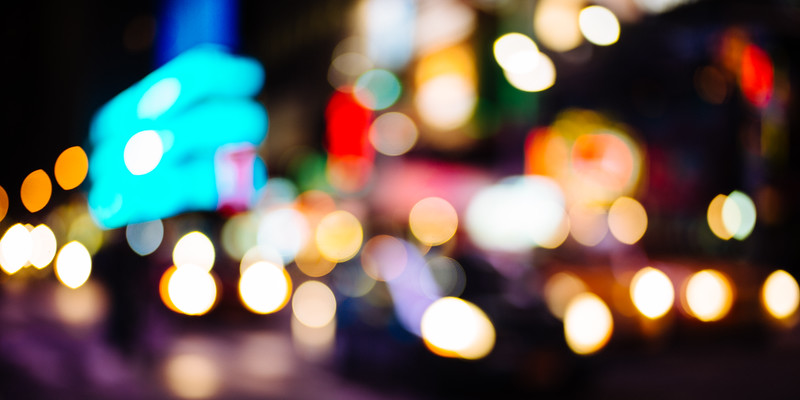 The lights of traffic and billboards in Times Square.