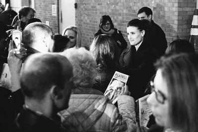 Idina Menzel signing autographs after a show.