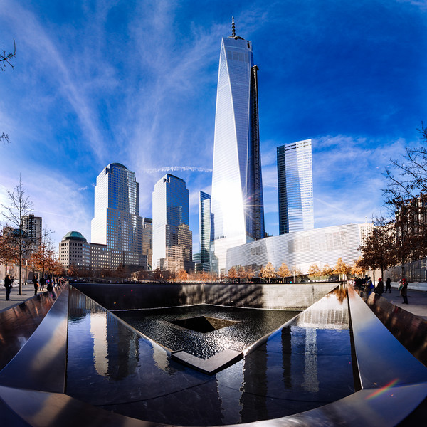 An 87 megapixel stitched panoramic from 12 images of The Freedom Tower and 9/11 Memorial. Towering 1776 feet, it overlooks the fountains which mark the footprints of the Twin Towers.