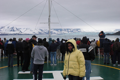"""We are on the 4th deck, bow, and the same place whatzisface said """"I'm the king of the world """" on that over-rated movie. And there's the glacier on the right. Given how close the cloud-cover comes to it, you should appreciate how TALL it is."""