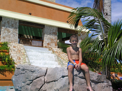 Iberostar Paraiso Lindo - Reid posing at the waterfall.