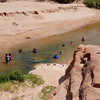 Locals cool off in the Virgin River, hot day