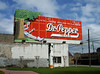 DR PEPPER BILLBOARD<br /> Here we are in the little town of Dublin, TX, home to the very first Dr Pepper bottling plant. There's no way to show this, but the girl is swinging in and out of the tree. Pretty cool!