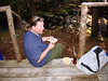 MASTER CHEF KEITH<br /> Keith enjoying the chowder of his labors. Hey, that's my house in that bag there! (Tent, ground cover, Therm-A-Rest mattress, and a hatchet to hammer in the stakes -- a pretty convenient package.)