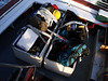 LOADS OF STUFF<br /> This trip out the the little island was a little different than past work details I've been on, as eight people went along on this one. Consequently, we had two pickup loads of work and personal stuff to take along with us, which required the boat company to loan us two wooden bins to put it all in. I thought we were going to have to use two boats!