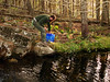 MAKIN' WATER<br /> One of the nice things about this cabin is the perpetually running stream out front. Even in the dry season -- such as my last time out -- there was still water to be had. This time it was rockin' right along. Here Chris filters drinking and cooking water for the group.