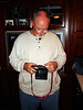 I WONDER WHAT THAT DOES?<br /> Dave and Ann's place<br /> <br /> Here's Dave (the pilot) attempting to outsmart his camera. With these new digital SLRs, it's not an easy task sometimes.