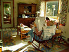 JOHN RELAXING<br /> Next morning and John is kicking back in the rocker with the morning paper.