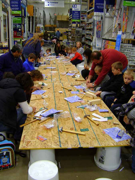 PROJECT DAY AT LOWE'S<br /> Since I delayed my departure from the area until around noon so as to hit up the Triple XXX Diner in W Lafayette again, I was able to accompany the gang to Lowe's Hardware for a kids' project day. Today the project is to build your own semi truck.