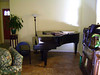 THE MUSIC ROOM<br /> Mary's pride and joy -- her Steinway piano. She's very good on it.