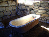 BATHTUB IN THE BARN<br /> I'm not sure if this is where they took their baths or not, or if it was just stored here after the new house was built. They may even have used it for a watering trough.