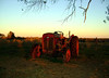 TRACTOR AT SUNSET<br /> I couldn't believe the color the sunset gave to this old tractor.
