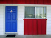 SARATOGA MOTEL - LAMPASAS, TEXAS<br /> Okay, does anyone else see a Texas flag here? Pretty clever paint scheme, I thought, and not a bad room, either. I highly recommend this motel if you're ever in Lampasas. This is my room from the outside.