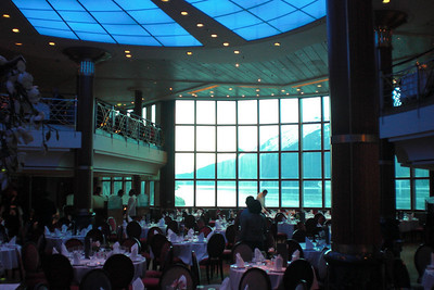 The view from the formal dining restaurant in the rear of the ship. The windows are two stories tall.