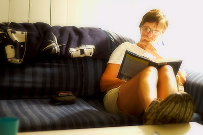 Mom reading in the front room of the MV house