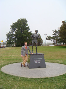 Michal poses with a commemorative statue of Terry Fox.