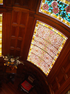 Inside the castle, which features a lot of stained glass.