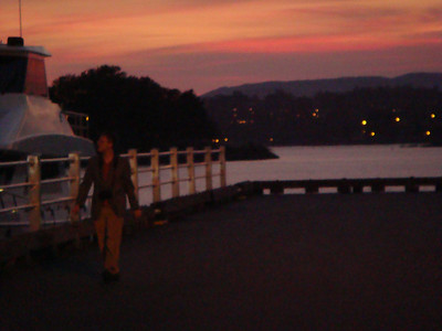Michal walks along the pier during sunset.