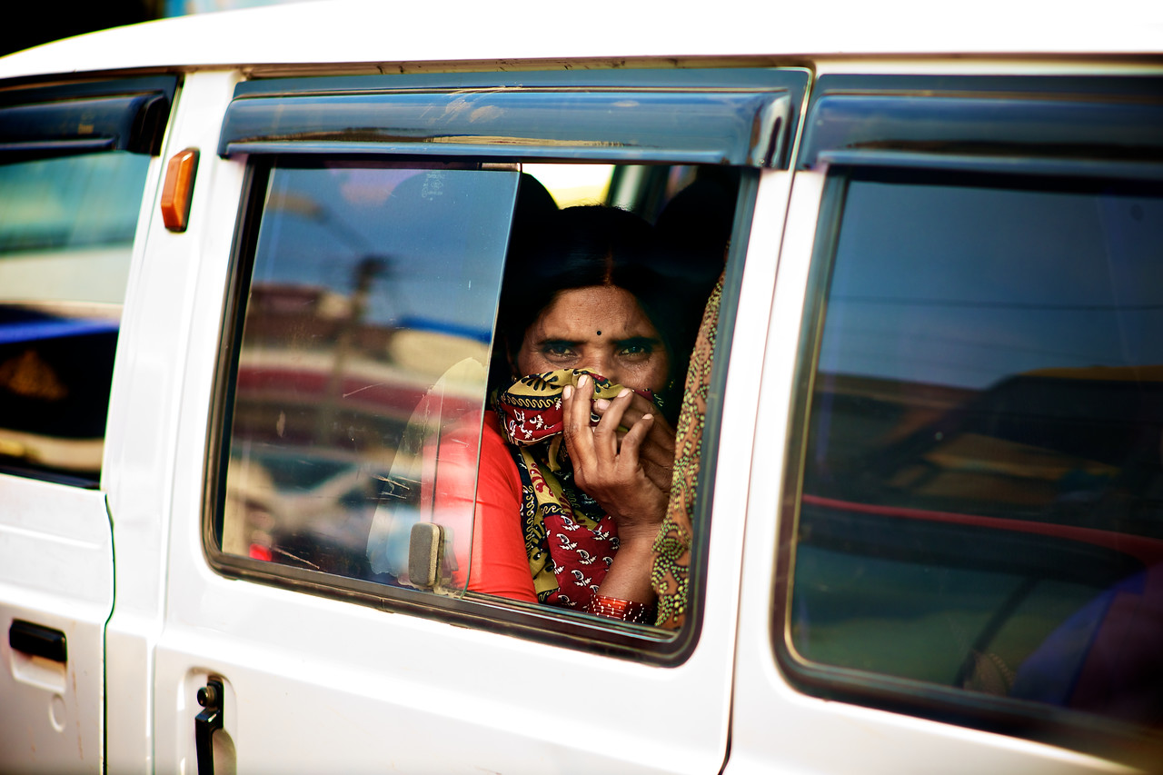 A woman hides her face from the camera.<br /> (India)