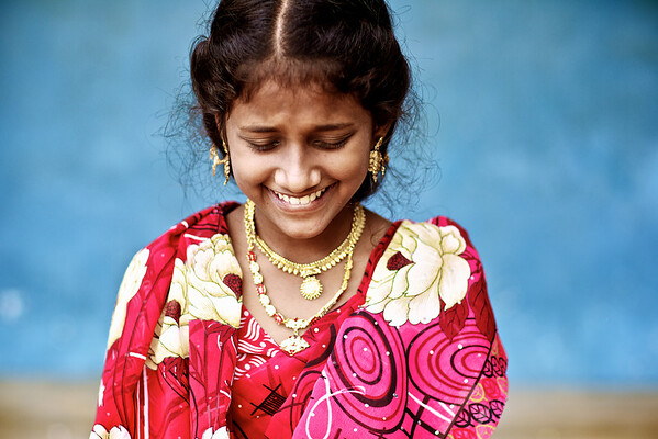 India - A female students flashes a bashful grin after a presentation.
