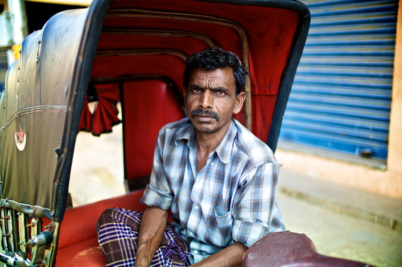 Rickshaw driver.<br /> (India)