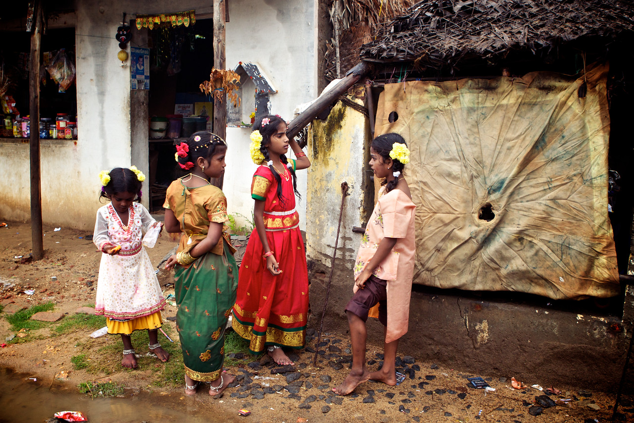 By American standards, these are harsh living conditions but it doesn't dampen the spirits of the beautiful Indian children who were dressed up and playing during Diwali (the festival of lights).<br /> (India)