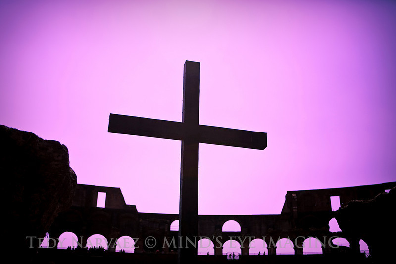 Artsy image of the cross in the Coliseum.