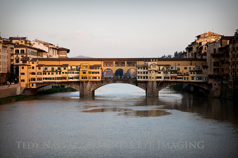 Ponte Vecchio at dusk. Those aren't homes on the bridge, they're mostly jewelry stores.