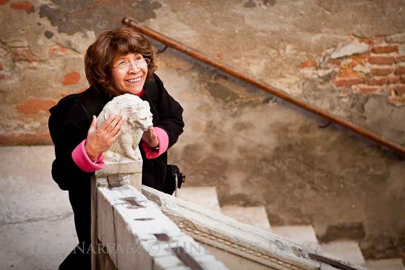 Mom posing in the stairwell of Hotel Palazzo Odoni (Venice).