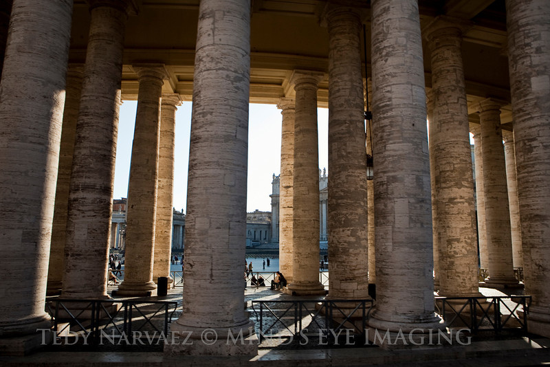 Majestic columns leading into the Vatican.