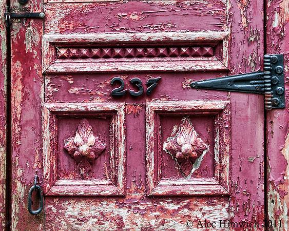Detail from the door to Peter Elliot's Garage in Friendship, ME.  This door once served as a door to a brothel in Bangor.