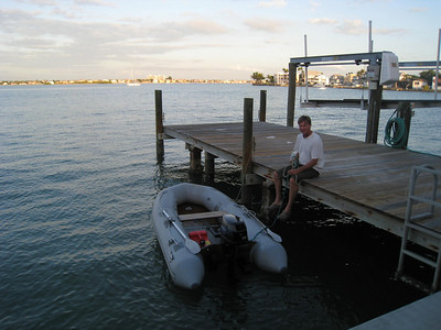 Gary at Dad's dock with Solsurfin anchored in background.
