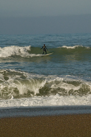 Riding the waves off San Simeon Park