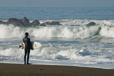 San Simeon Park, surfer contemplating the ocean swells