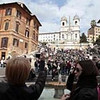 This Tuesday, March 22, 2011 photo shows tourists as they take a pictures of the Spanish Steps and Trinita' dei Monti Church in central Rome. The Vatican travel agency for pilgrimages said prices on rooms might tumble in the coming weeks because predictions of upward of 1 million people pouring into the city for Pope John Paul II's beatification ceremony could scare off potential hotel guests.    (AP Photo/Gregorio Borgia)
