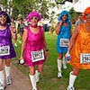 FILE-  This Sunday, June 2, 2002 file photo shows runners dressed as dancers from left, Ellen Vitro, Marilyn Bullard, Suzy Loveless and Elena Frees as they head to the starting line at the Rock 'n' Roll Marathon in San Diego, Calif. Started in 1998, the Rock ëní Roll Marathon series is the champion of destination races. True to its name, these runs are as much a party as a competition.   (AP Photo/Denis Poroy, File)
