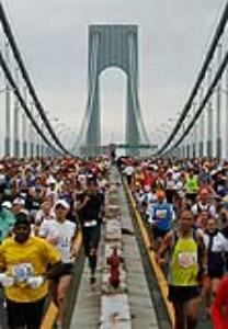 FILE-   This Sunday, Nov. 1, 2009 file photo shows runners as they cross the Verrazano Narrows Bridge at the start of the ING New York City Marathon in New York. Runners have always traveled to race. The status of the Boston and New York City marathons has attracted participants from around the world.    (AP Photo/Jason DeCrow, File)