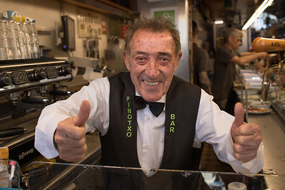 Flamboyant Juanito Bayén owner of Bar Pinoxto, the world's best tapas bar.  La Boqueria, Barcelona. Photo by Weldon Weaver. June 2019.