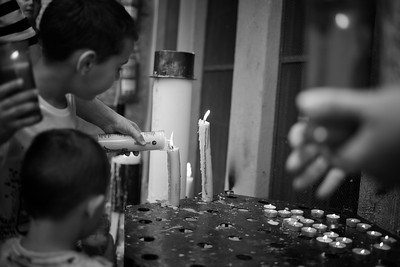 Papa lights the candles at the Basilica at Montserrat, Catalonia Spain. Photo by Weldon Weaver. June 2019.