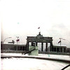 Jan 1968 (British Sector) That's the Brandenburg Gae with the infamous wall in front of it. That stand is just for people to get up on to see into the East. This picture was taken from the tour bus.