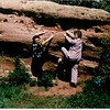 Grandma and Ila rockclimbing in polyester pantsuits.