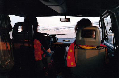 LEAVING DALLAS On Stemmons Freeway at rush hour, of all things. We even got to witness a pile-up as a piece of duct pipe flew out of a truck to our left and bolluxed up a couple of cars trying to get out of the way. Whew! That was close. Leigh is at the helm (it's her vehicle, after all) with Carolyn riding shotgun. Roger and I bring up the rear.