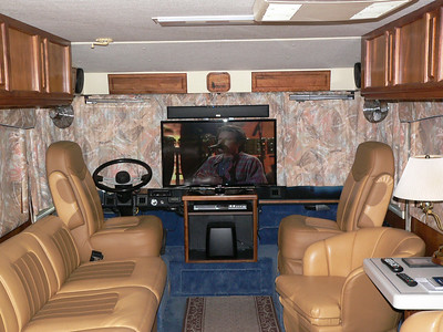 Flat screen TV, sound bar, DVR/DVD player/recorder and sub-woofer.