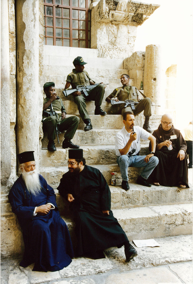 Israel: Socializing outside The Church of the Holy Sepulcher<br /> (How diverse can you get?).