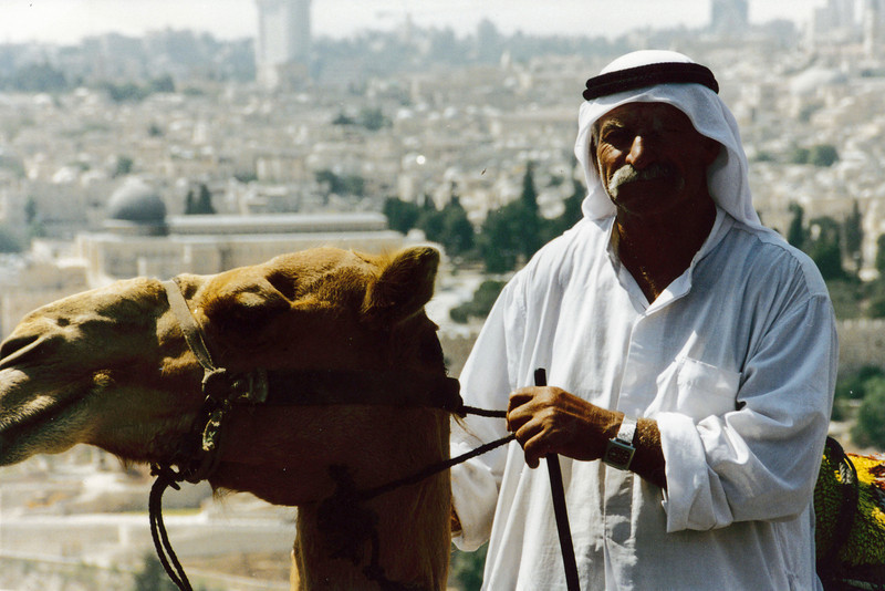 Israel: Bedouin with Jerusalem in the background.